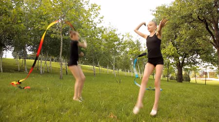 gimnastyka : Girls engage in rhythmic gymnastics with Ribbon on the nature Wideo