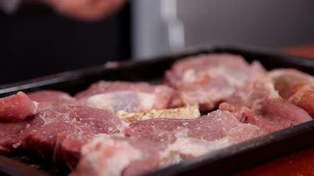 wagyu : Chef peppers chopped meat on a baking sheet Stock Footage
