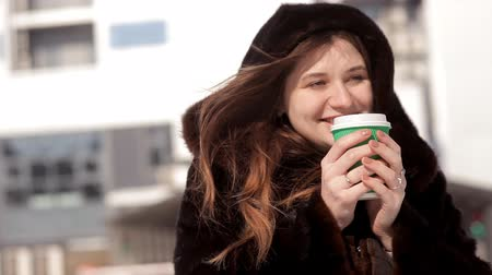 oneperson : Frozen girl drinking coffee in the winter on the street