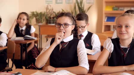 go to school : two girls in uniform laughing on the lesson at school