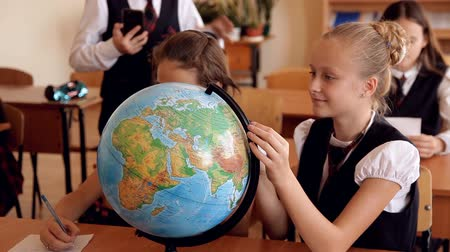 стенд : children in uniform on the lesson of geography