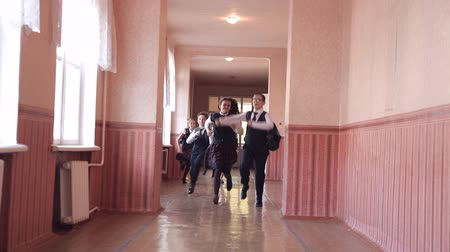 recess : A group of children running along the corridor in the school Stock Footage