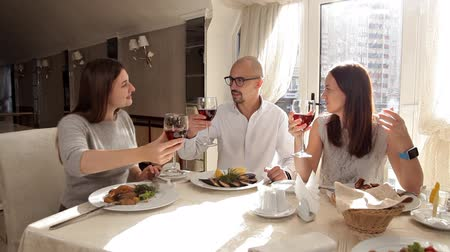 chefs table : Friends have dinner in a restaurant and drink wine Stock Footage