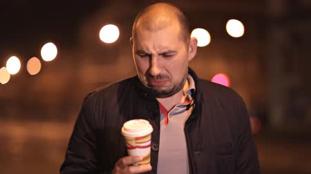 displeasure : Young guy tries disgusting coffee posing in front of the camera