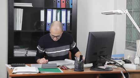 insects isolated : a man working in the office in the workplace. too much work Stock Footage
