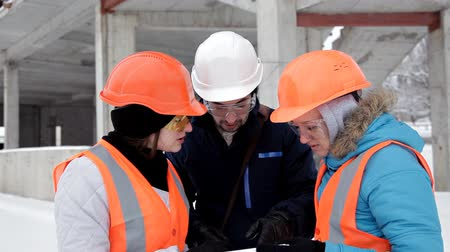 kalap : Two female inspectors and architects discuss with head engineer about construction project