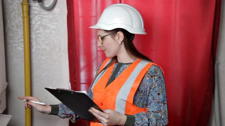 argon : Female engineer checks the data of the heating system equipment in the boiler room