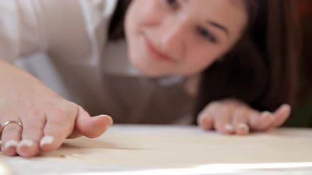 turn table : The girl smoothes the dough with Stock Footage