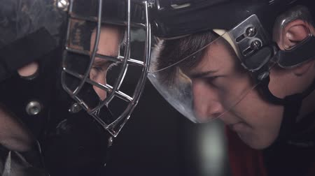 professionally : hockey goalkeeper and forward or striker face to face. a battle of wills