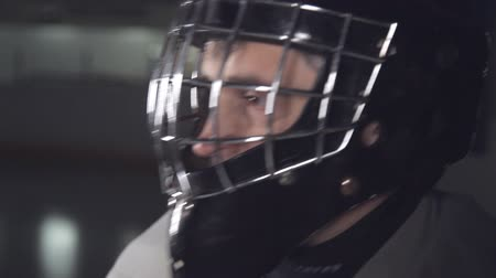 free throw : hockey goalkeeper wears a helmet and raises his hand showing the referee that he is ready