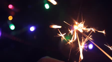 bengali : burning Sparkler on the background of the tree. close up