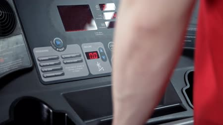treadmill : A man makes a slow walk on the treadmill in the gym Stock Footage