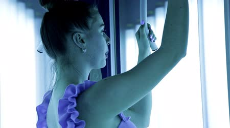 solarium : A beautiful girl with a healthy body standing in the Solarium of the Spa has a beautiful figure. Tan, skin