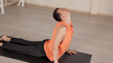 meditující : Man practicing yoga in the hall.Bright Studio with large Windows and mirrors. Sportswear