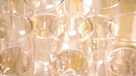 frothy : Glasses with champagne close up Stock Footage