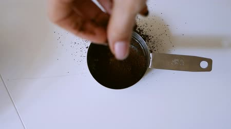 poured out : Girl sprinkles honey with spices in a mini pan Stock Footage