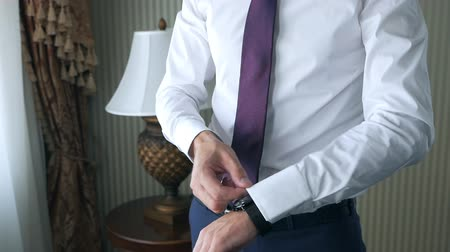 classical suit : Groom wearing wrist watches closeup