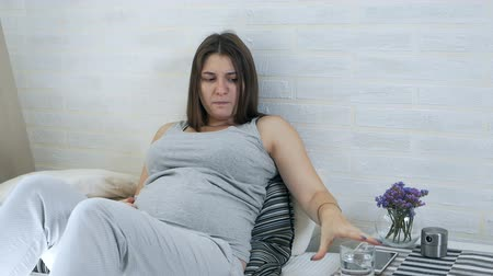 vomit : Nausea and vomiting. Pregnancy intoxication. Pregnant girl restless Stock Footage