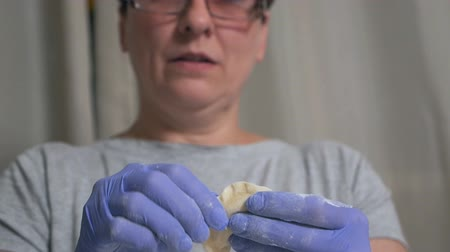 chefs table : Woman in glasses closeup sculpts ravioli, ravioli. National cuisine Stock Footage