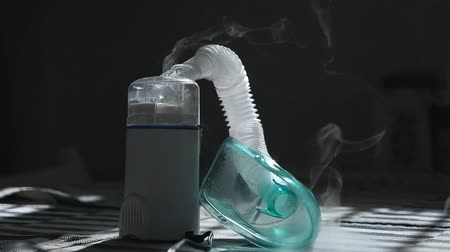 csőrendszer : inhaler mask closeup with steam. Medical product. Cold treatment