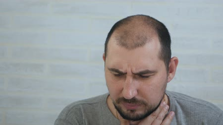острый : An upset man coughs violently and holds his throat. Acute respiratory viral infection. Cold illness.