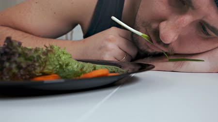 desire : A bald fat vegetarian disgustingly eats salad. Proper nutrition, healthy lifestyle Stock Footage