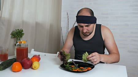 bosszús : Fat man refuses to eat healthy food. Diet concept. Man hates vegetarian diet
