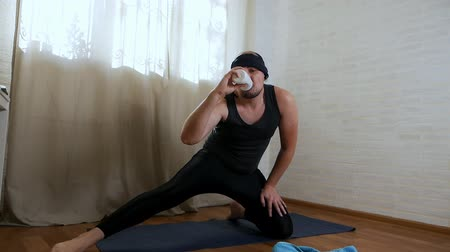 смелый : Funny fat man is trying to do yoga exercises on the rug. Brutal male yogi in tight clothes