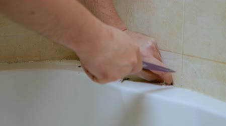 mold : The concept of cleaning mold and rust in the bath. Mold at the seams in the bathroom Stock Footage