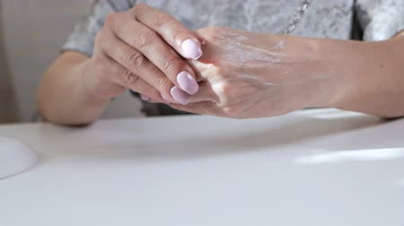 tırnak : Woman aged puts cream on her hands, a natural product for skin care at home Stok Video