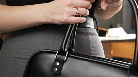 Demonstration video of a leather bag in a leather workshop close-up. Leather goods