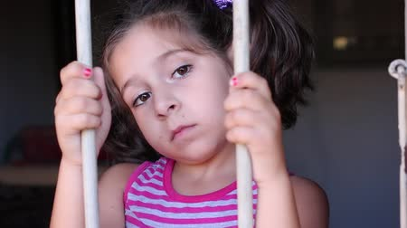 depressão : Cute little girl behind bars. Desperate little girl