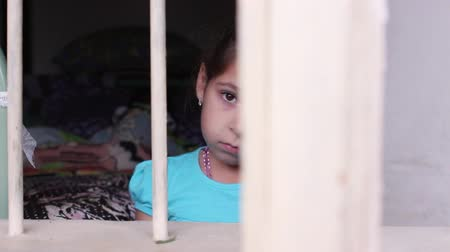 одиноко : Cute little girl behind bars. Desperate little girl