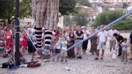 tightrope : Street artists. walking a tightrope