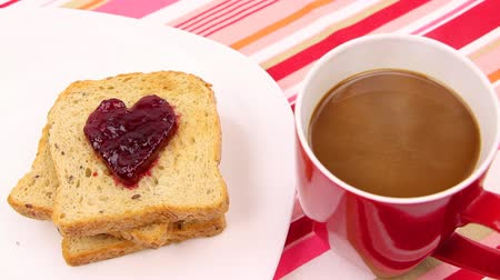 хлеб : Breakfast scene with a heart of red jam. Be my valentine