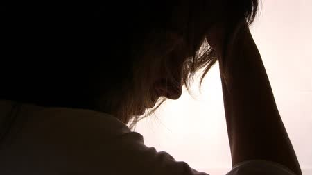smutek : Silhouette of a desperate girl