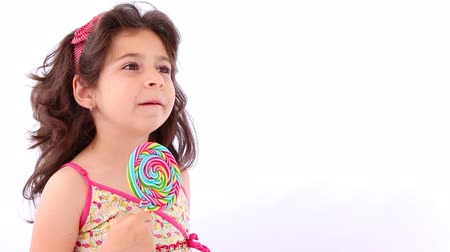 lambida : Little girl licking a lollipop, close up