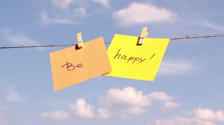 iyi olmak : sentence be happy on colorful paper pinched on a rope. Positive thinking concept. Stok Video