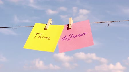 diferença : sentence Think Different on colorful paper pinched on a rope. Positive thinking concept.