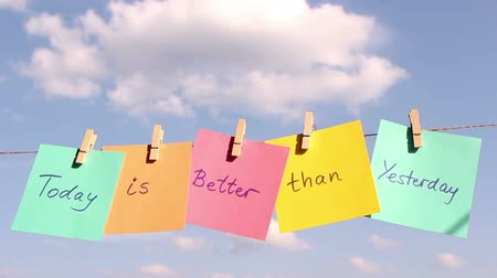 лучше : sentence Today Is Better Then Yesterday on colorful paper pinched on a rope. Positive thinking concept.