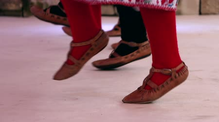 step : Bulgarian traditional dancers play in beautiful costumes, feet only