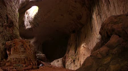 barlang : Prohodna cave in Bulgaria with two eye-like holes in its ceiling, known as the Eyes of God