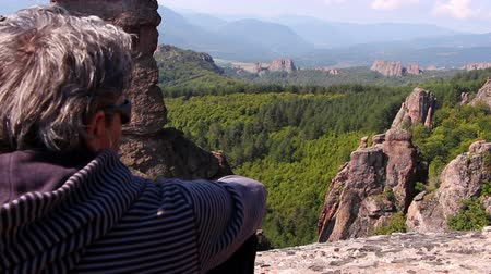 superb : Man sitting on a rock and admiring the beautiful Belogradchik valley