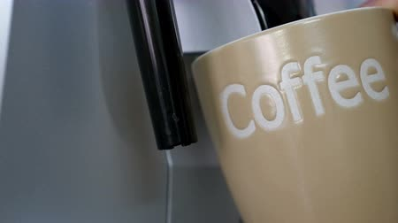 overfill : Coffee maker fills cup of coffee Stock Footage