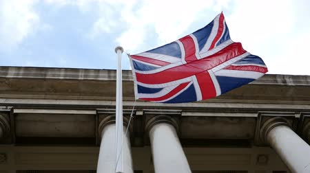 büyük britanya : British flag waving in wind in UK, United Kingdom, national symbol Stok Video