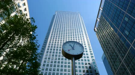 docklands : Time lapse of one of the six public clocks in front of the famous business office block One Canada Square in Canary Wharf, London