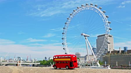 giant wheel : Stop motion of the famous London red bus passing by London Eye in London, part 3