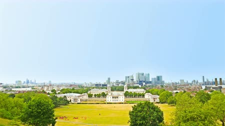 Greenwich park in London, the famous financial district Canary Wharf on background Stock Footage