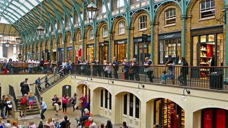 covent : UNITED KINGDOM, LONDON - JUNE 13, 2015: London lifestyle. Musicians entertain the audience in Covent Garden market