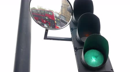 tükör : UNITED KINGDOM, LONDON - JUNE 15, 2015: Stoplight with mirron in London city turning red to green Stock mozgókép